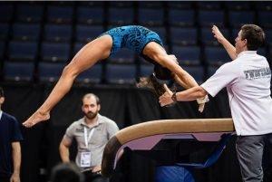 gymnast getting spot on vault